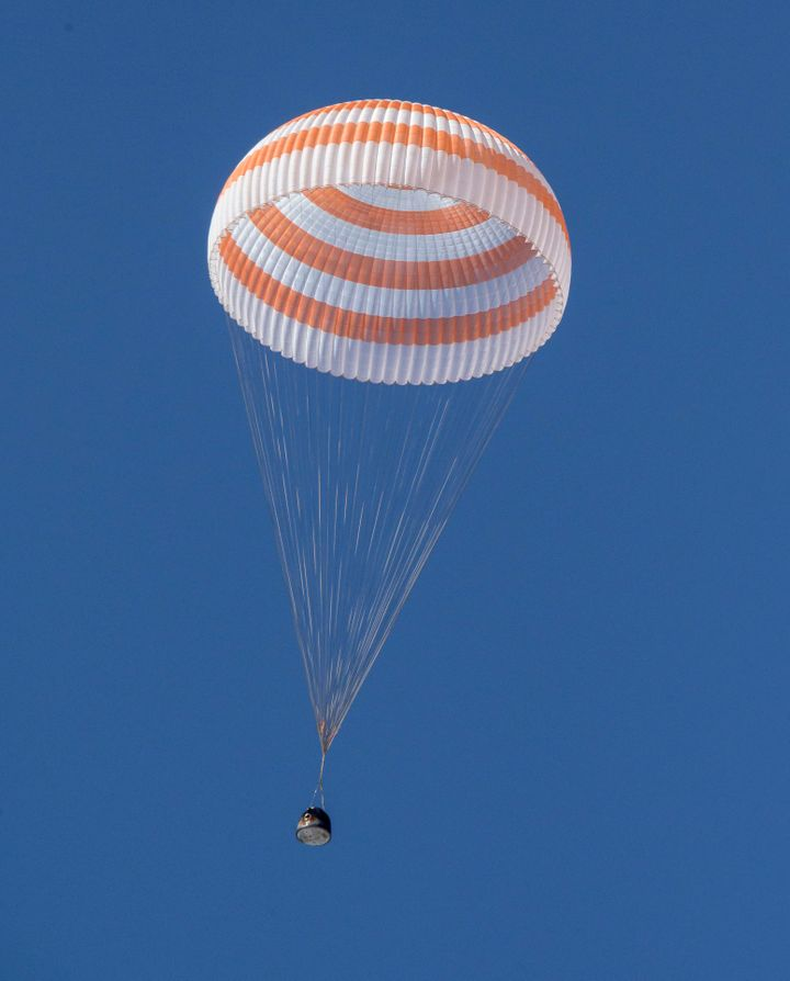 The Soyuz MS-17 spacecraft lands in a remote area near the town of Zhezkazgan, Kazakhstan, Saturday, April 17, 2021.