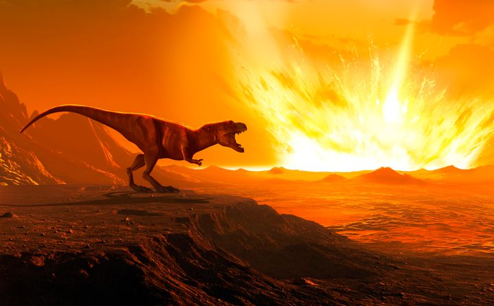 Illustration of a Tyrannosaurus as an asteroid strikes the earth.