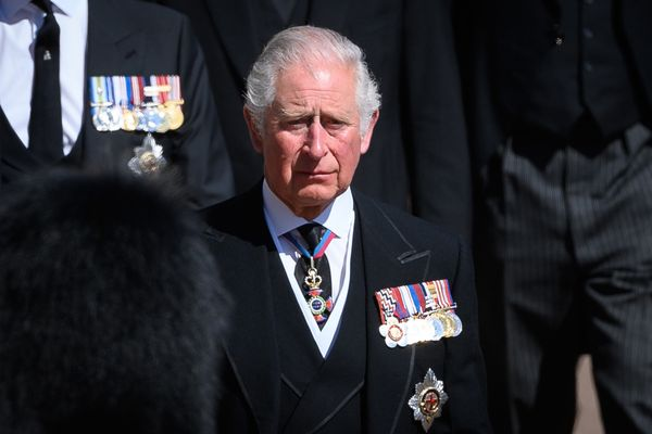 Prince Charles cries as he walks behind his father's coffin.
