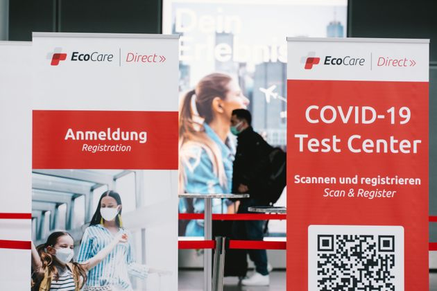a man is seen walks pass a Coronavirus test center at Duessedorf airport, Germany on March 26, 2021 as...