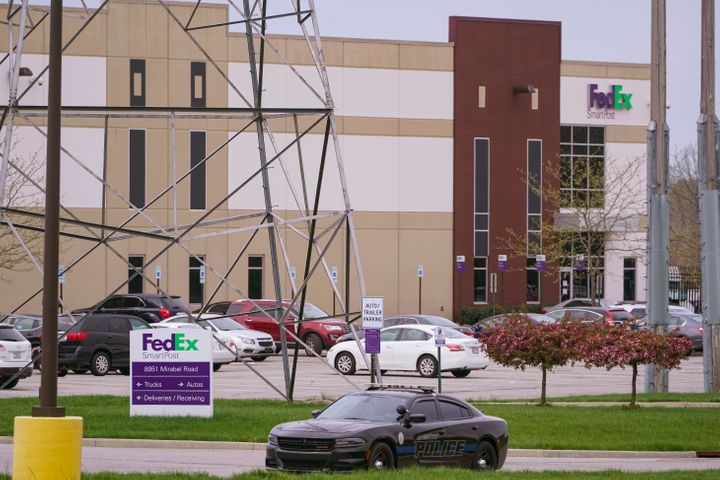 A sheriff's car blocks the entrance to the FedEx facility in Indianapolis, Saturday, April 17, 2021 where eight people were k