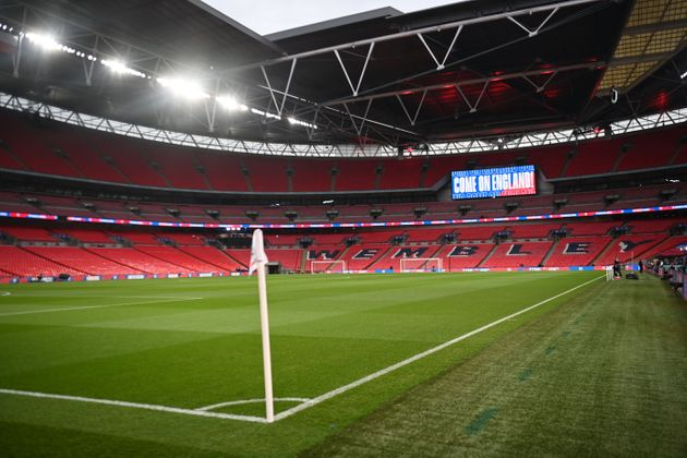 A picture shows the empty interior of Wembley Stadium in London on March 31, 2021 ahead of the FIFA World...