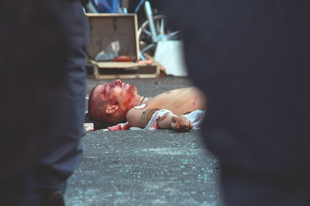 (Original Caption) A young protester was shot dead by a member of the carabinieri, during the anti-globalization...