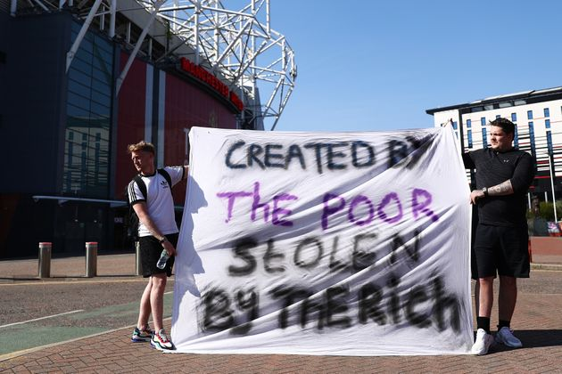 Football fans opposing the European Super League outside Manchester United's Old Trafford stadium on