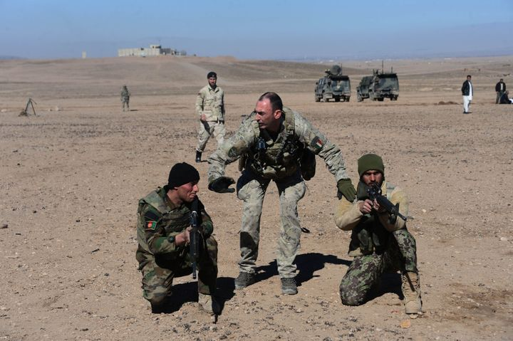 An Italian soldier (center) trains Afghan military personnel in 2017.