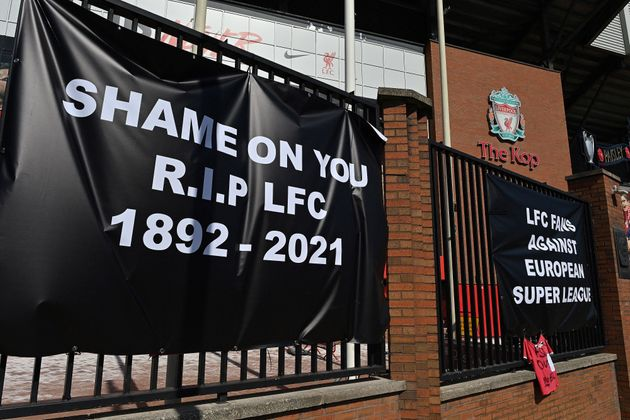 Anti-European Super League posters hang outside Anfield, home of