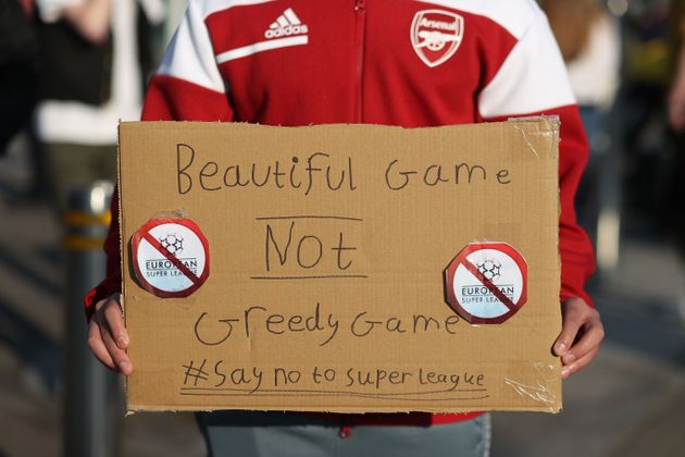Fans display banners at The Emirates opposing Arsenal signing up for the newly proposed Super