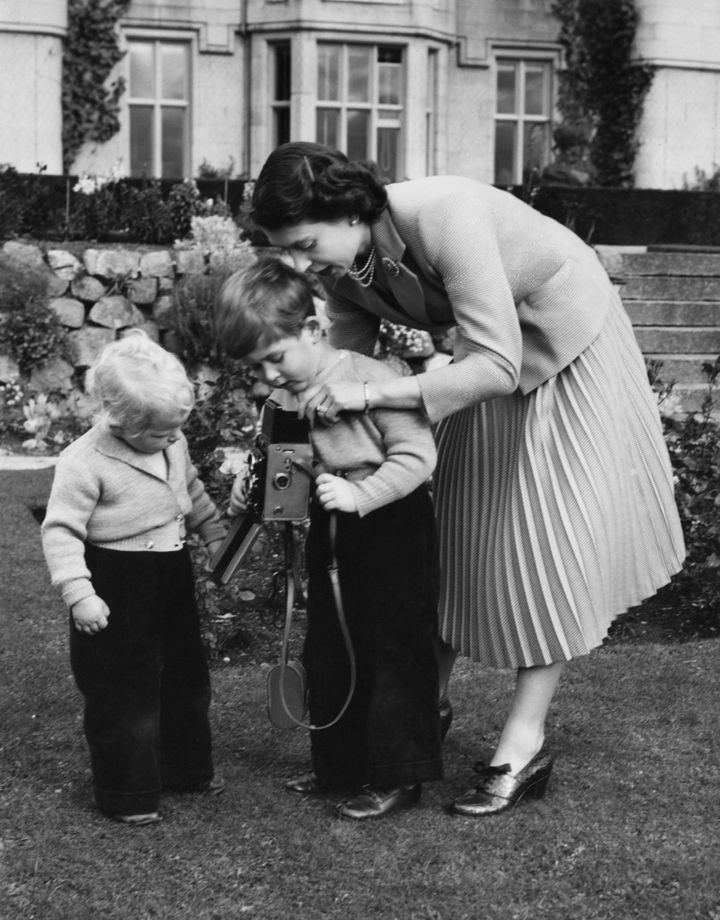 Queen Elizabeth II helps Prince Charles take a picture of his sister, Princess Anne, in Balmoral, Scotland, in 1952.