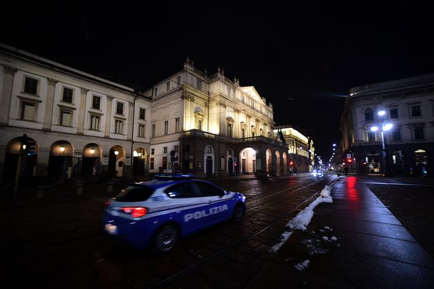 MILAN, ITALY - DECEMBER 31: A view of Piazza della Scala with a police car on December 31, 2020 in Milan,...