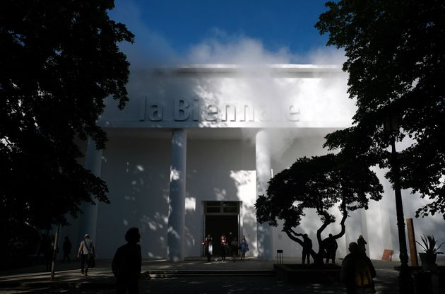 VENICE, ITALY - May 16: The steam rising from the roof of the Giardini's main pavilion is the work 'Thinking...