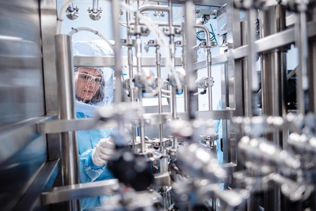 epa09000800 A handout photo made available by German pharmaceuticals company BioNTech shows an employee...