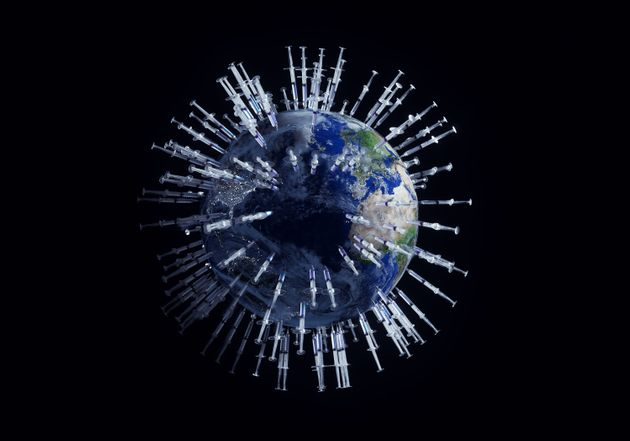 Digital generated image of many syringes with Covid-19 vaccine stuck into planet Earth visualising global