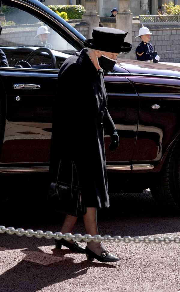 Queen Elizabeth walking into the chapel.
