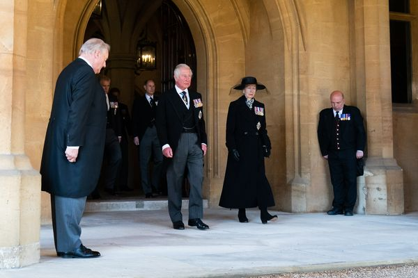 The Prince of Wales and The Princess Royal follow the Land Rover Defender carrying the Duke of Edinburgh's coffin