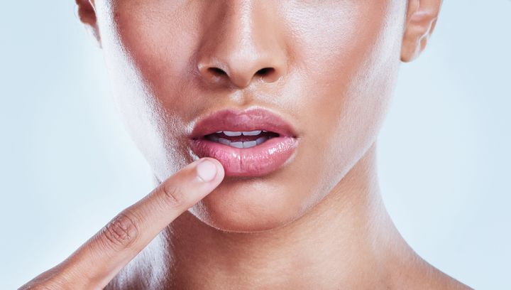 You may be surprised to learn you're putting something secreted from sheep on your lips.