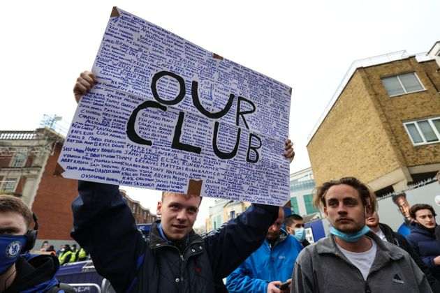 LONDON, ENGLAND - 20 April 2021: Fans gather to protest the introduction of the European Super League...