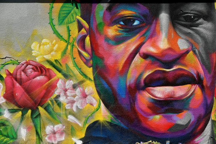 A mural of George Floyd is seen on a wall along Colfax Avenue on June 7, 2020, in Denver. Floyd's killer, former police offic
