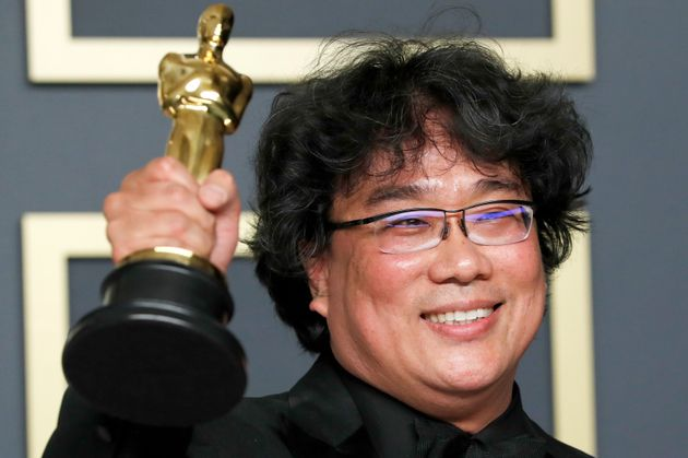 Bong Joon Ho poses with the Oscar for Best Picture for