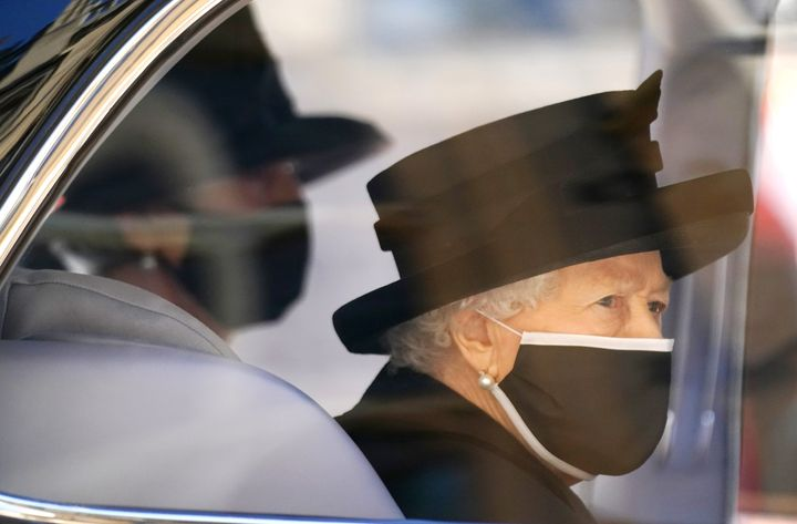 WINDSOR, ENGLAND - APRIL 17: Queen Elizabeth II arrives for the funeral of Prince Philip, Duke of Edinburgh at St George's Chapel at Windsor Castle on April 17, 2021 in Windsor, England. Prince Philip of Greece and Denmark was born 10 June 1921, in Greece. He served in the British Royal Navy and fought in WWII. He married the then Princess Elizabeth on 20 November 1947 and was created Duke of Edinburgh, Earl of Merioneth, and Baron Greenwich by King VI. He served as Prince Consort to Queen Elizabeth II until his death on April 9 2021, months short of his 100th birthday. His funeral takes place today at Windsor Castle with only 30 guests invited due to Coronavirus pandemic restrictions. (Photo by Victoria Jones - WPA Pool/Getty Images)