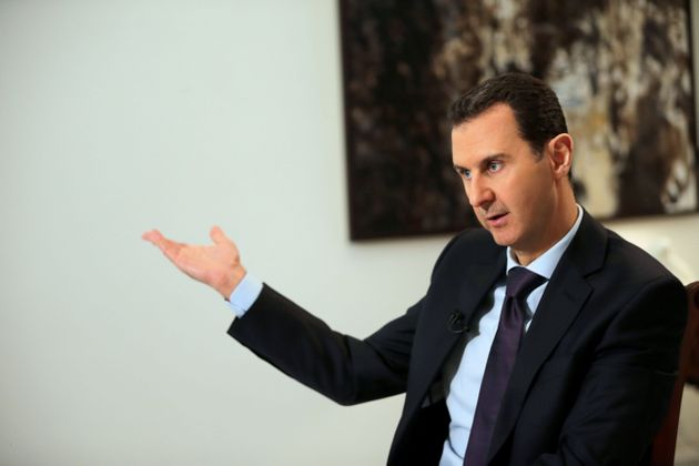 Syrian President Bashar al-Assad gestures during an exclusive interview with AFP in the capital Damascus...
