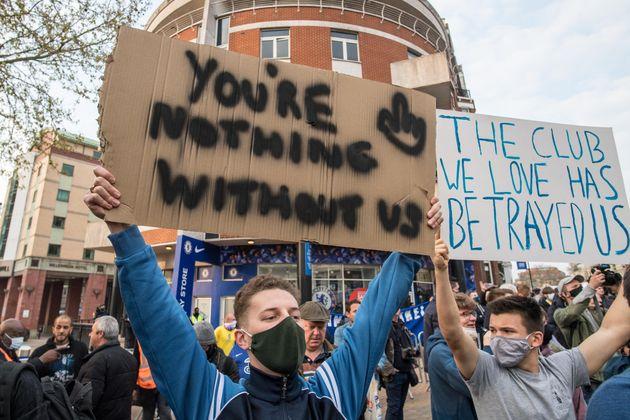 LONDON, ENGLAND - APRIL 20: Fans protest against Super League before the Premier League match between...