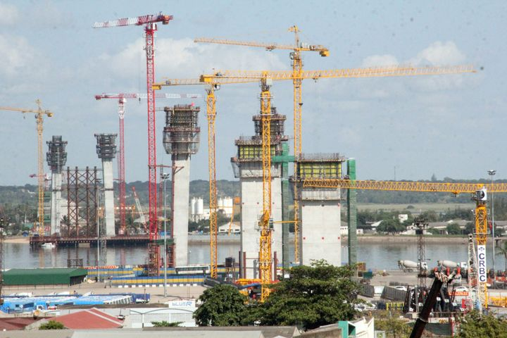 Cranes constructing the Katembe suspension bridge in gas-rich Mozambique's capital Maputo.