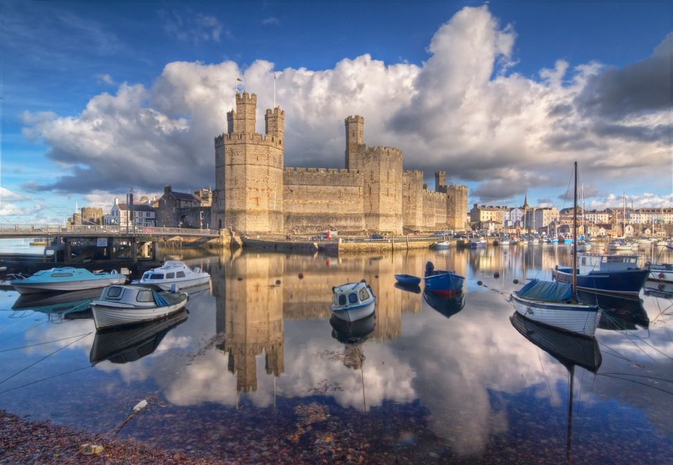 King Edward I of England replaced an 11th century castle with the current Caernarfon Castle in the late 13th century.