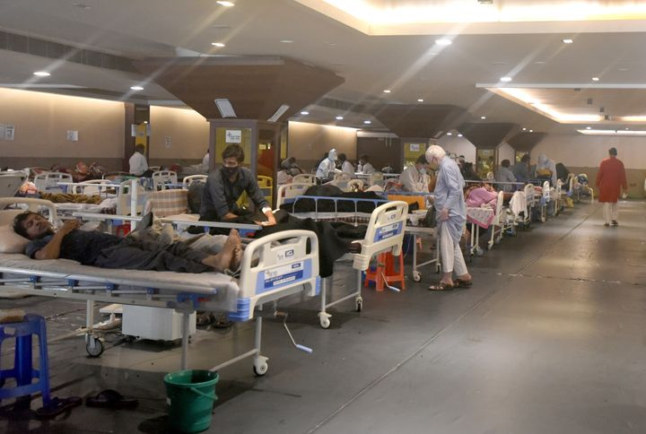 Coronavirus patients receive treatment at Shehnai Banquet Hall COVID-19 care centre attached to LNJP Hospital in New Delhi, I
