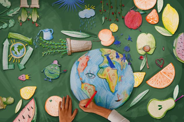Children's hands drawing the planet