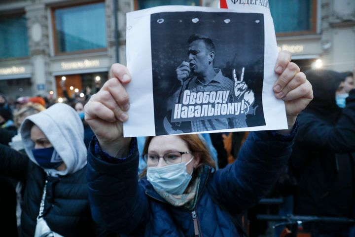 """A activist holds a poster reading """"Freedom for Navalny!"""" during the opposition rally in support of jailed opposition leader A"""