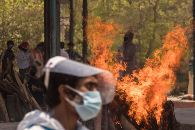 NEW DELHI, INDIA - APRIL 22: Multiple funeral pyres can be seen burning as people perform the last rites...