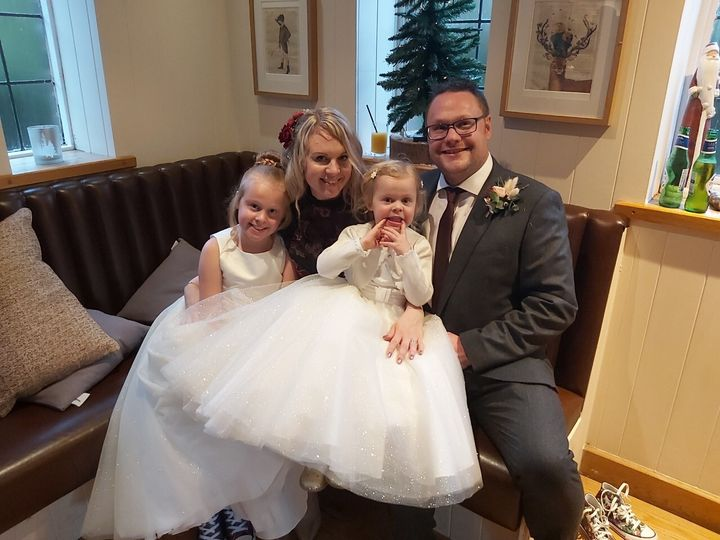 Toni Edwards-Beighton with husband Matt and daughters Phoebe and Willow.