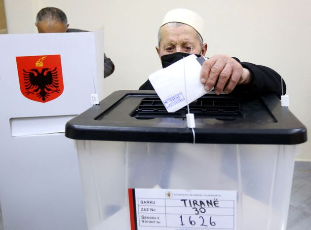 A man casts his vote during the Parliamentary elections at a polling station in the village of Surrel,...