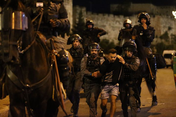 JERUSALEM - APRIL 23: Israeli forces intervene Palestinian Muslims, who gathered in Damascus Gate after performing Tarawih pr