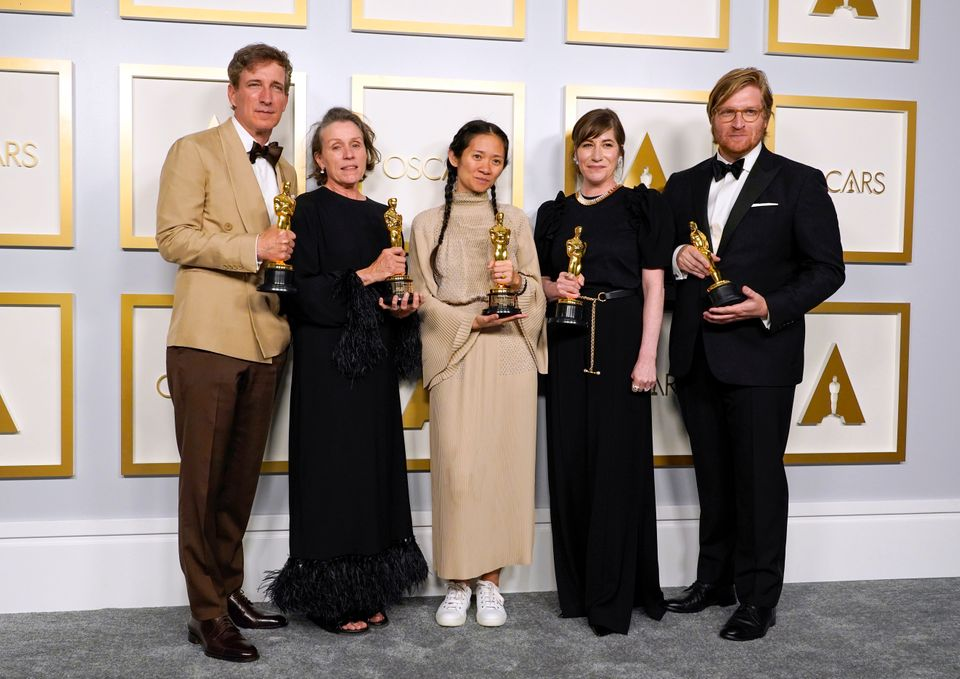 LOS ANGELES, CALIFORNIA - APRIL 25: (L-R) Peter Spears, Frances McDormand, Chloe Zhao, Mollye Asher,...