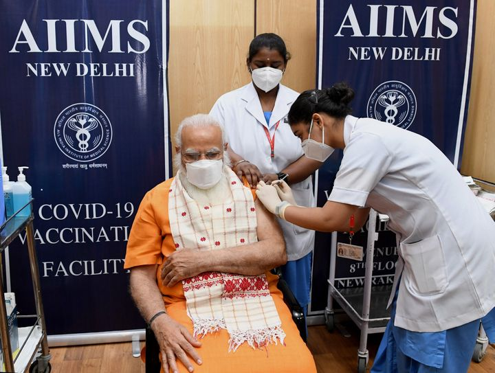 Indian Prime Minister Narendra Modi receives the second dose of the Covaxin coronavirus vaccine April 8 at a hospital in New