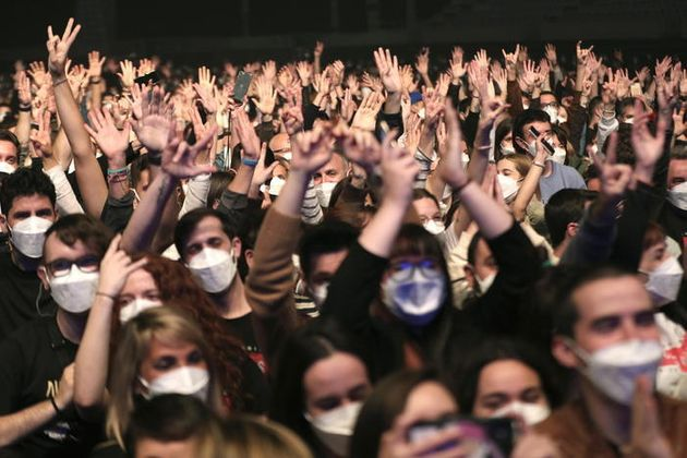 epa09101747 Members of the audience react as the Spanish band Love of Lesbian performs on stage in front...