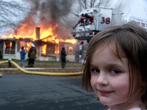 "The <a href=""https://knowyourmeme.com/memes/disaster-girl"" target=""_blank"">""Disaster Girl"" meme</a>."