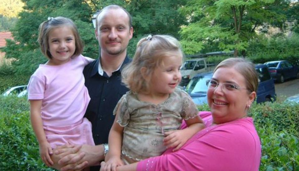 Frederika and her husband Simon with their two daughters when they were