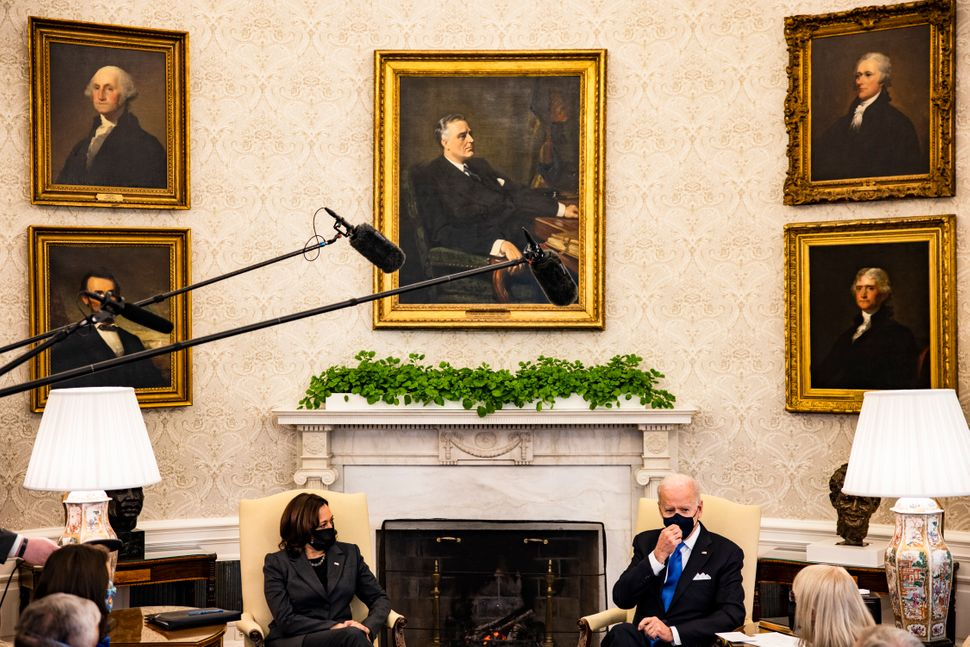 President Joe Biden sits beneath a painting of Franklin Roosevelt during a meeting with Vice President Kamala Harris and othe