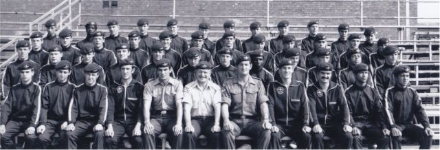Christopher is pictured with his platoon (second row, fifth from