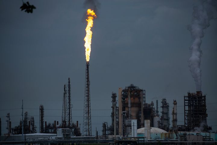 A gas flare from the Shell Chemical LP petroleum refinery illuminates the sky on Aug. 21, 2019, in Norco, Louisiana.