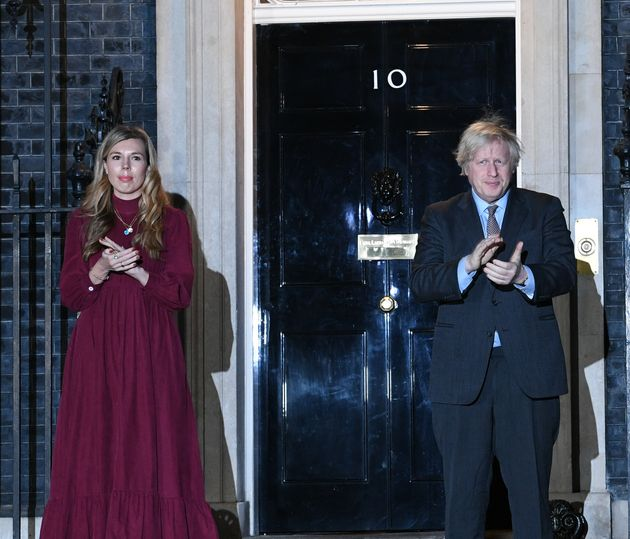 Boris Johnson and his partner Carrie Symonds stand outside 10 Downing