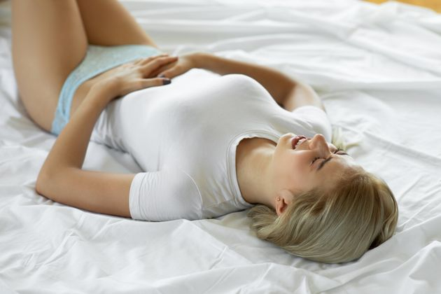 Woman having stomach cramps and abdominal pain