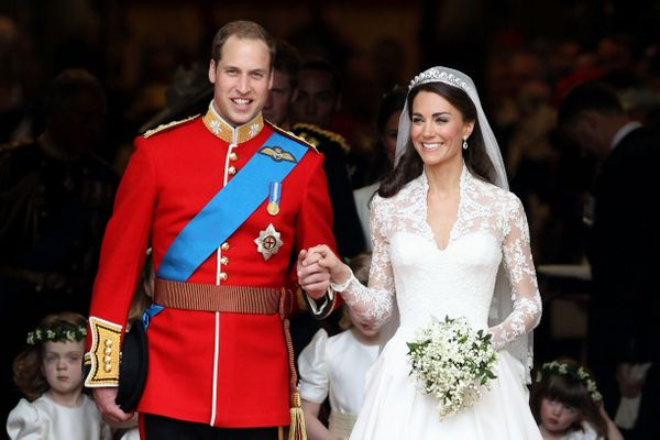 The new Duke and Duchess of Cambridge smile following their royal wedding ceremony at Westminster Abbey on April 29, 201