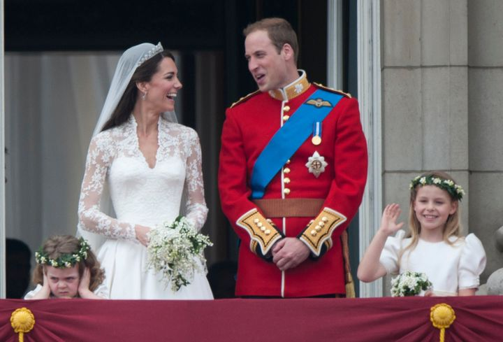 The newlyweds sharing a moment on the balcony of Buckingham Palace following their wedding at Westminster Abbey on April 29, 2011, in London.