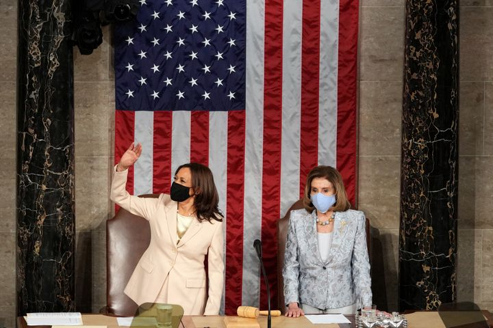 US Vice President Kamala Harris (L) waves as Speaker of the US House of Representatives Nancy Pelosi, Democrat of California,