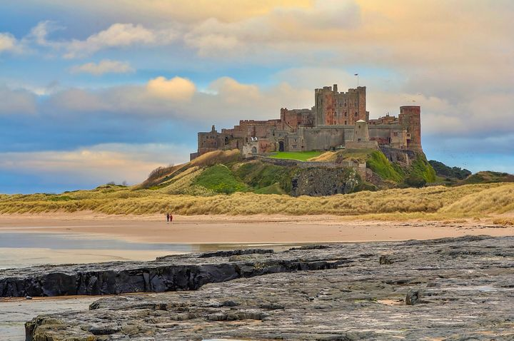 Bamburgh Castle is located on the coast at Bamburgh, Northumberland, England.