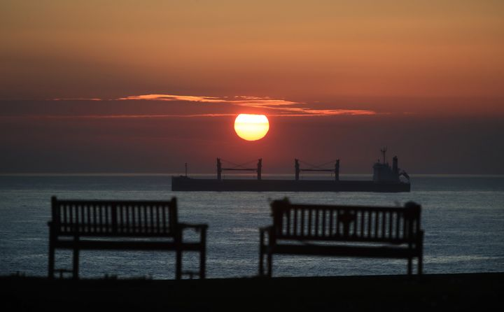 The sun rises over the North East coast at Tynemouth.