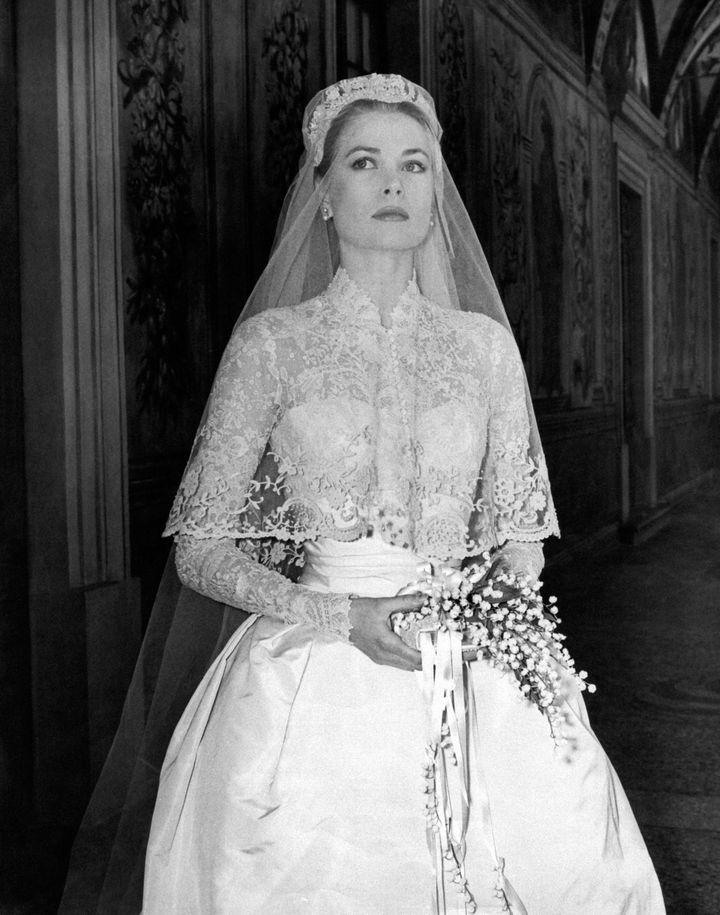 Movie star Grace Kelly photographed in her bridal dress just before the wedding ceremony where she will marry Ranier III of Monaco on April 18th, 1956.